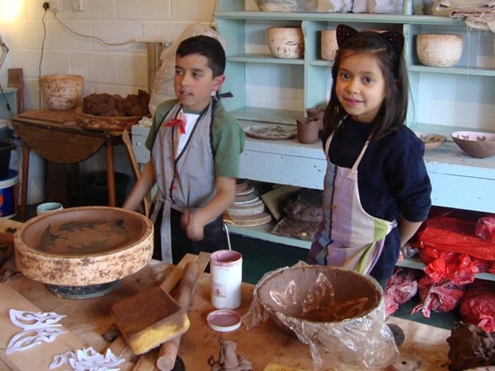 children making clay pots
